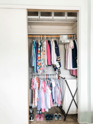 kids clothes hanging in closet