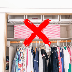 red x over same color bins in kids closet